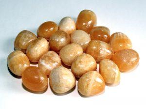 Highly polished Orange Calcite tumble stone size 2-3 cm.