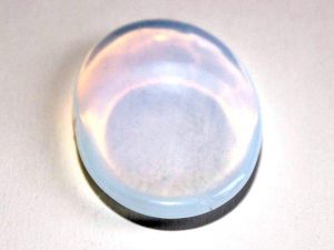 Highly polished Opalite thumb stone 40 x 30 mm.