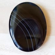 Highly polished Black Banded Agate thumb stone 40 x 30 mm. The thumb stones have been designed to have a pleasing feel with the highest quality finish. They are shaped to fit beautifully between the thumb and fingers. Being a natural product these stones may have natural blemishes and vary in colour and banding. www.naturalhealingshop.co.uk based in Nuneaton for crystals, spiritual healing, meditation, relaxation, spiritual development,workshops.