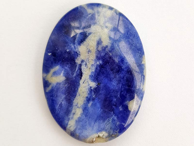 Highly polished Sodalite thumb stone 40 x 30 mm. The thumb stones have been designed to have a pleasing feel with the highest quality finish. They are shaped to fit beautifully between the thumb and fingers. Being a natural product these stones may have natural blemishes and vary in colour and banding. www.naturalhealingshop.co.uk based in Nuneaton for crystals, spiritual healing, meditation, relaxation, spiritual development,workshops.