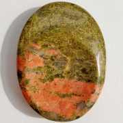 Highly polished Unakite thumb stone 40 x 30 mm. The thumb stones have been designed to have a pleasing feel with the highest quality finish. They are shaped to fit beautifully between the thumb and fingers. Being a natural product these stones may have natural blemishes and vary in colour and banding. www.naturalhealingshop.co.uk based in Nuneaton for crystals, spiritual healing, meditation, relaxation, spiritual development,workshops.