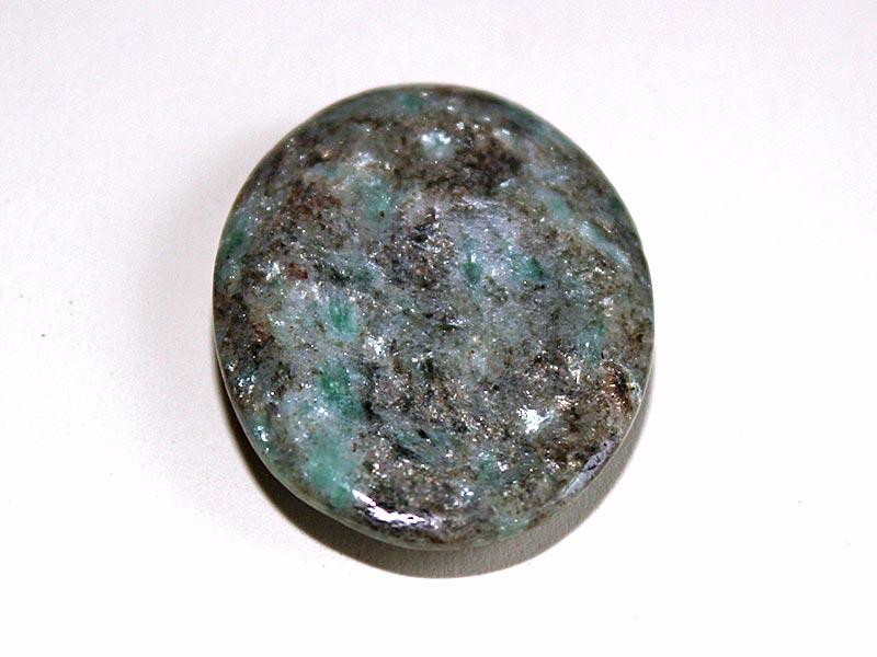 Highly polished Chrome-Mica thumb stone.