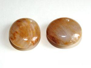 Polished Quartz Golden Healer pebble approximately 45 mm diameter.