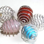 Spiral cage for tumble stones