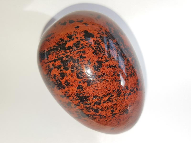 Highly polished Mahogany Jasper egg approx height 45 mm.