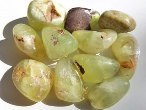 Highly polished Prehnite tumble stone size 35 mm.