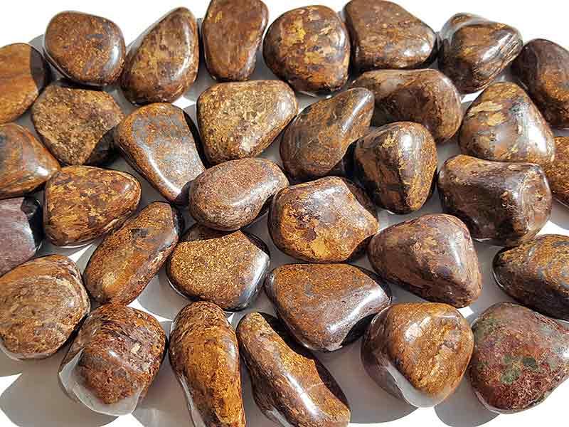Highly polished Bronzite tumble stone size 20-30 mm.