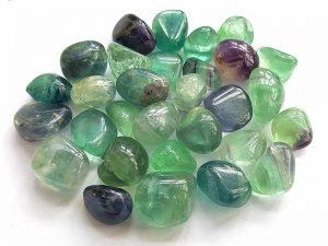 Highly polished Rainbow Fluorite tumble stone size 20-30 mm.