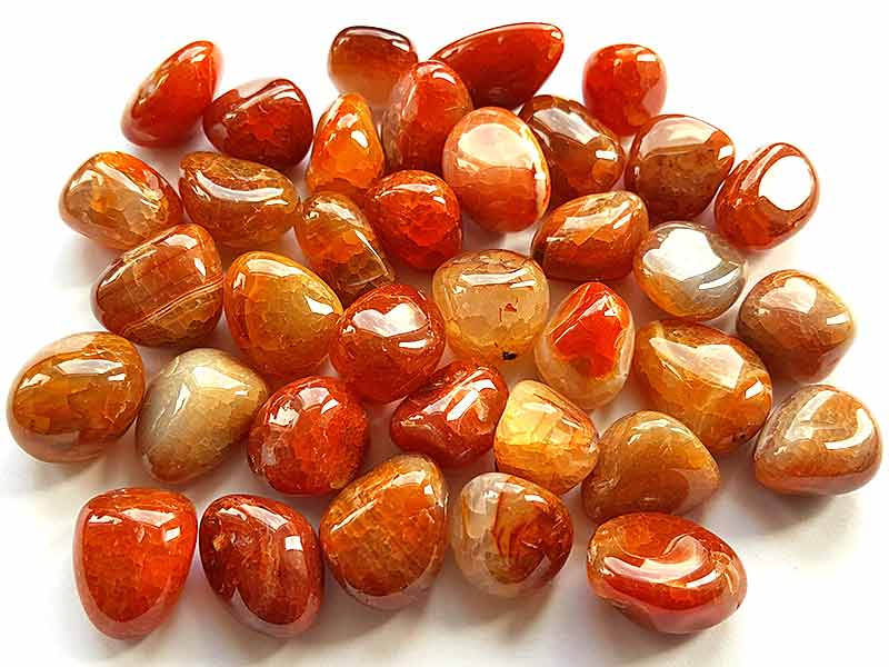 Highly polished Fire Agate tumble stone size 2-3 cm.
