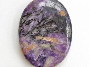 Highly polished charoite thumb stone.