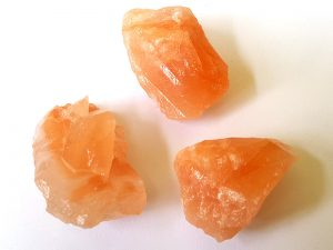 Coral Calcite 20-25 mm x 35-40 mm approx. Being a natural product these stones may have natural blemishes and vary in colour and banding. www.naturalhealingshop.co.uk based in Nuneaton for crystals, spiritual healing, meditation, relaxation, spiritual development,workshops.