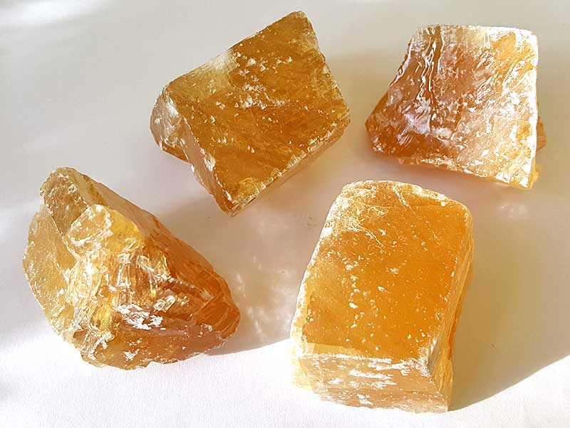 Honey Calcite 30-35 mm x 35-40 mm approx. Being a natural product these stones may have natural blemishes and vary in colour and banding. www.naturalhealingshop.co.uk based in Nuneaton for crystals, spiritual healing, meditation, relaxation, spiritual development,workshops.