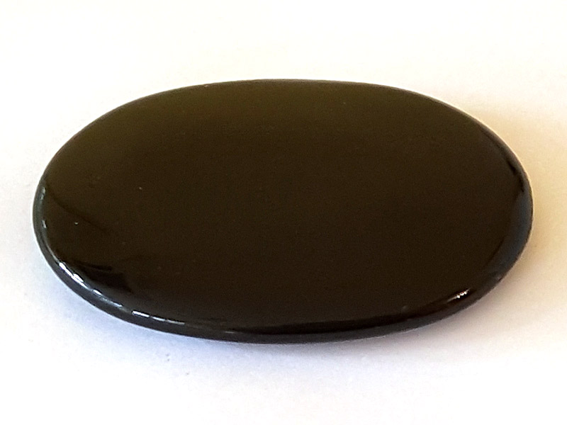Highly polished Black Obsidian palm stone 70 x 40 mm. The palm stones are made from the best grade rough materials to produce a well finished, highly polished product. Used by crystal healers and general therapists for massage and similar treatments. Also perfect for collectors. Being a natural product these stones may have natural blemishes and vary in colour and banding. www.naturalhealingshop.co.uk based in Nuneaton for crystals, spiritual healing, meditation, relaxation, spiritual development,workshops.