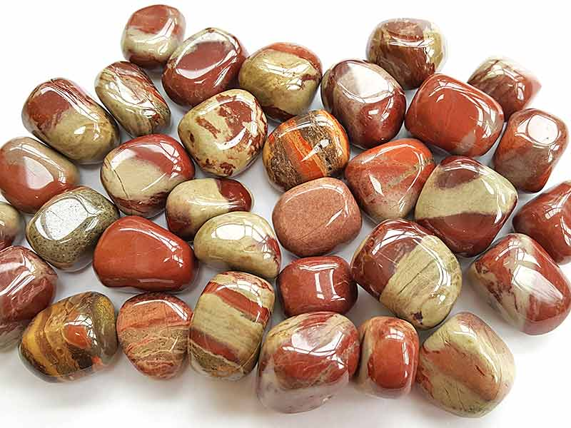 Highly polished Red Rhyolite tumble stone size 2-3 cm. www.naturalhealingshop.co.uk based in Nuneaton for crystals, spiritual healing, meditation, relaxation, spiritual development,workshops.