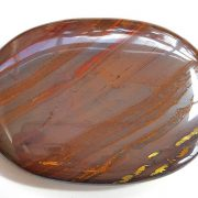 Highly polished Tiger Iron palm stone 70 x 40 mm. The palm stones are made from the best grade rough materials to produce a well finished, highly polished product. Used by crystal healers and general therapists for massage and similar treatments. Also perfect for collectors. Being a natural product these stones may have natural blemishes and vary in colour and banding. www.naturalhealingshop.co.uk based in Nuneaton for crystals, spiritual healing, meditation, relaxation, spiritual development,workshops.