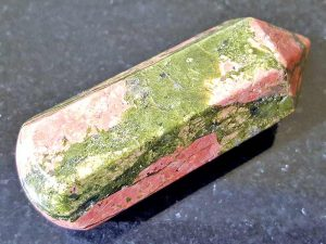 Highly polished Unakite Wand wand approximate height 55 mm Used in crystal healing and meditation. Excellent for collectors. Being a natural product this crystal may have natural blemishes and vary in colour. www.naturalhealingshop.co.uk based in Nuneaton for crystals, spiritual healing, meditation, relaxation, spiritual development,workshops.