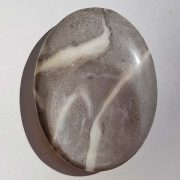 Highly polished shell jasper thumb stone 40 x 30 mm. The thumb stones have been designed to have a pleasing feel with the highest quality finish. They are shaped to fit beautifully between the thumb and fingers. Being a natural product these stones may have natural blemishes and vary in colour and banding. www.naturalhealingshop.co.uk based in Nuneaton for crystals, spiritual healing, meditation, relaxation, spiritual development,workshops.