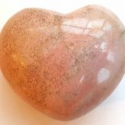 Highly polished Rhodonite Heart approx 45 mm. These hearts are perfect for a gift! There are purple velvet pouches or organza bags you can purchase to pop them into for the finishing touch. Being a natural product these stones may have natural blemishes and vary in colour and banding. www.naturalhealingshop.co.uk based in Nuneaton for crystals, spiritual healing, meditation, relaxation, spiritual development,workshops.