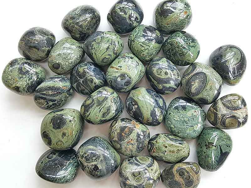 Highly polished Kambara Jasper tumble stone size 2-3 cm. Being a natural product these stones may have natural blemishes and vary in colour, banding and shape. See photograph. www.naturalhealingshop.co.uk based in Nuneaton for crystals, spiritual healing, meditation, relaxation, spiritual development,workshops.