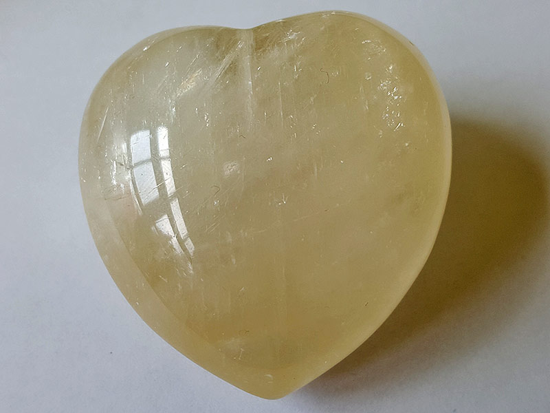 Highly polished Yellow Calcite Heart approx 45 mm. These hearts are perfect for a gift! There are purple velvet pouches or organza bags you can purchase to pop them into for the finishing touch. Being a natural product these stones may have natural blemishes and vary in colour and banding. www.naturalhealingshop.co.uk based in Nuneaton for crystals, spiritual healing, meditation, relaxation, spiritual development,workshops.