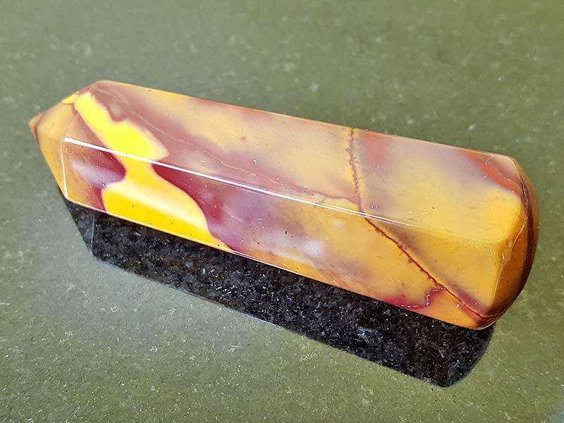 Highly polished Mookaite Jasper wand approximate height 65 mm Used in crystal healing and meditation. Excellent for collectors. www.naturalhealingshop.co.uk based in Nuneaton for crystals, spiritual healing, meditation, relaxation, spiritual development,workshops.