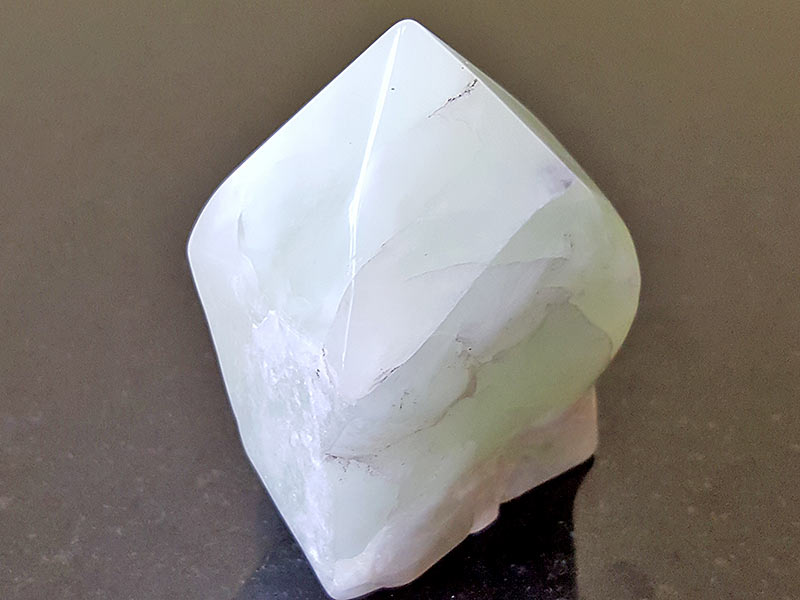 Highly polished New Jade Point approximate height 60 mm. Being a natural product this crystal may have natural blemishes and vary in colour. www.naturalhealingshop.co.uk based in Nuneaton for crystals, spiritual healing, meditation, relaxation, spiritual development,workshops.