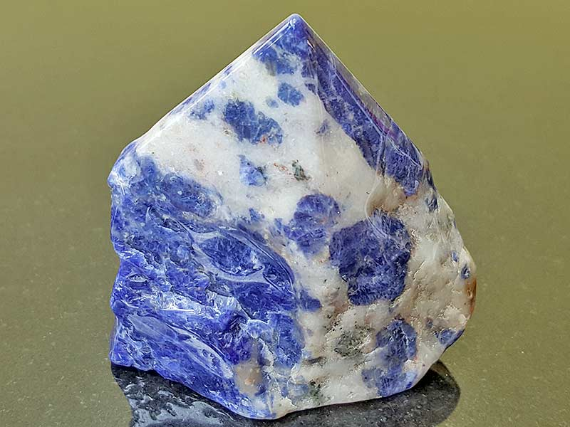Highly polished Sodalite Point approximate height 70 mm. Being a natural product this crystal may have natural blemishes and vary in colour. www.naturalhealingshop.co.uk based in Nuneaton for crystals, spiritual healing, meditation, relaxation, spiritual development,workshops.