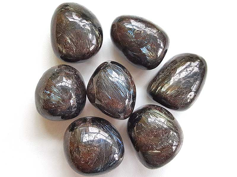 Highly polished Astrophyllite tumble stone size 2.5-3 cm Being a natural product this crystal may have natural blemishes and vary in colour. www.naturalhealingshop.co.uk based in Nuneaton for crystals, spiritual healing, meditation, relaxation, spiritual development,workshops.