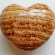 Highly polished Aragonite Heart approx 45 mm. These hearts are perfect for a gift! There are purple velvet pouches or organza bags you can purchase to pop them into for the finishing touch. Being a natural product these stones may have natural blemishes and vary in colour and banding. www.naturalhealingshop.co.uk based in Nuneaton for crystals, spiritual healing, meditation, relaxation, spiritual development,workshops.