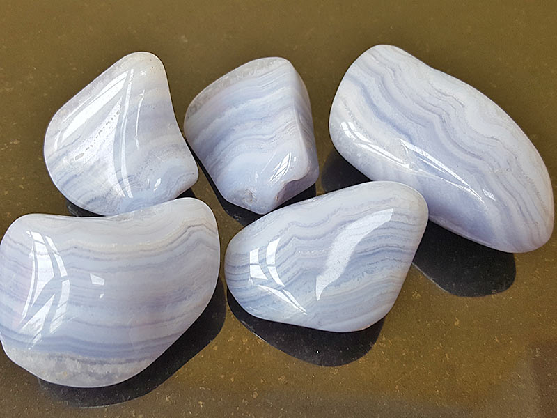 Highly polished Blue Lace Agate tumble stone size 30 to 40 mm. Being a natural product this crystal may have natural blemishes and vary in colour. www.naturalhealingshop.co.uk based in Nuneaton for crystals, spiritual healing, meditation, relaxation, spiritual development,workshops.