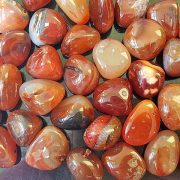 Highly polished Red Carnelian tumble stone size 2-3 cm Being a natural product this crystal may have natural blemishes and vary in colour. www.naturalhealingshop.co.uk based in Nuneaton for crystals, spiritual healing, meditation, relaxation, spiritual development,workshops.