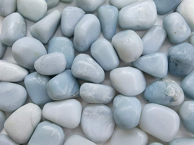 Highly polished Blue Chalcedony tumble stone size 2-3 cm. Being a natural product these stones may have natural blemishes and vary in colour, banding and shape. See photograph. www.naturalhealingshop.co.uk based in Nuneaton for crystals, spiritual healing, meditation, relaxation, spiritual development,workshops.