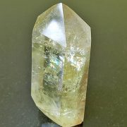 Citrine polished point with cut base approx height 80 mm. Beautiful sparkles and rainbows within the point. Being a natural product the crystal may have natural blemishes and vary in colour. www.naturalhealingshop.co.uk based in Nuneaton for crystals, spiritual healing, meditation, relaxation, spiritual development,workshops.