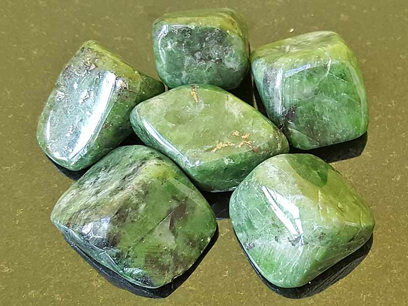 Highly polished Diopside tumble stone size 2.5-3 cm Being a natural product this crystal may have natural blemishes and vary in colour. www.naturalhealingshop.co.uk based in Nuneaton for crystals, spiritual healing, meditation, relaxation, spiritual development,workshops.