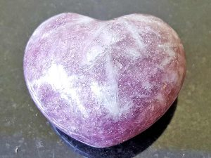 Highly polished Lepidolite Heart approx 45 mm. These hearts are perfect for a gift! There are purple velvet pouches or organza bags you can purchase to pop them into for the finishing touch. Being a natural product these stones may have natural blemishes and vary in colour and banding. www.naturalhealingshop.co.uk based in Nuneaton for crystals, spiritual healing, meditation, relaxation, spiritual development,workshops.