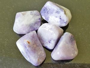 Highly polished Morado Opal (Violet Flame) tumble stone size 20 to 25 mm. Being a natural product this crystal may have natural blemishes and vary in colour. www.naturalhealingshop.co.uk based in Nuneaton for crystals, spiritual healing, meditation, relaxation, spiritual development,workshops.