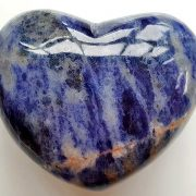 Highly polished Sodalite Heart approx 45 mm. These hearts are perfect for a gift! There are purple velvet pouches or organza bags you can purchase to pop them into for the finishing touch. Being a natural product these stones may have natural blemishes and vary in colour and banding. www.naturalhealingshop.co.uk based in Nuneaton for crystals, spiritual healing, meditation, relaxation, spiritual development,workshops.