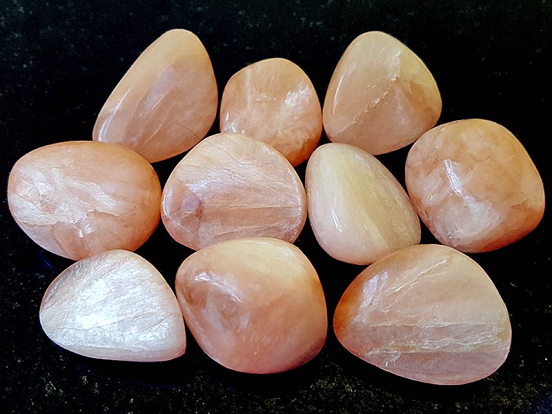 Highly polished Stilbite tumble stones size 25 to 30 mm. Being a natural product these stones may have natural blemishes and vary in colour, banding and shape. www.naturalhealingshop.co.uk based in Nuneaton for crystals, spiritual healing, meditation, relaxation, spiritual development,workshops.