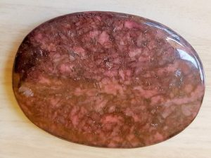 Highly polished Rhodonite palm stone 70 x 40 mm. The palm stones are made from the best grade rough materials to produce a well finished, highly polished product. Used by crystal healers and general therapists for massage and similar treatments. Also perfect for collectors. Being a natural product these stones may have natural blemishes and vary in colour and banding. www.naturalhealingshop.co.uk based in Nuneaton for crystals, spiritual healing, meditation, relaxation, spiritual development,workshops.