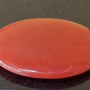 Highly polished carnelian palm stone 70 x 40 mm. The palm stones are made from the best grade rough materials to produce a well finished, highly polished product. Used by crystal healers and general therapists for massage and similar treatments. Also perfect for collectors. Being a natural product these stones may have natural blemishes and vary in colour and banding. www.naturalhealingshop.co.uk based in Nuneaton for crystals, spiritual healing, meditation, relaxation, spiritual development,workshops.