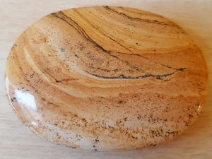 Highly polished picture jasper palm stone 70 x 40 mm. The palm stones are made from the best grade rough materials to produce a well finished, highly polished product. Used by crystal healers and general therapists for massage and similar treatments. Also perfect for collectors. Being a natural product these stones may have natural blemishes and vary in colour and banding. www.naturalhealingshop.co.uk based in Nuneaton for crystals, spiritual healing, meditation, relaxation, spiritual development,workshops.