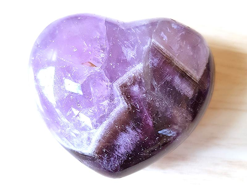 Highly polished Amethyst Chevron Heart approx 45 mm. These hearts are perfect for a gift! There are purple velvet pouches or organza bags you can purchase to pop them into for the finishing touch. Being a natural product these stones may have natural blemishes and vary in colour and banding. www.naturalhealingshop.co.uk based in Nuneaton for crystals, spiritual healing, meditation, relaxation, spiritual development,workshops.