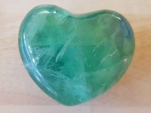 Highly polished Fluorite Heart approx 45 mm. www.naturalhealingshop.co.uk based in Nuneaton for crystals, spiritual healing, meditation, relaxation, spiritual development,workshops.