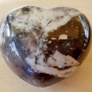 Highly polished Merlinite Heart approx 45 mm. These hearts are perfect for a gift! There are purple velvet pouches or organza bags you can purchase to pop them into for the finishing touch. Being a natural product these stones may have natural blemishes and vary in colour and banding. www.naturalhealingshop.co.uk based in Nuneaton for crystals, spiritual healing, meditation, relaxation, spiritual development,workshops.