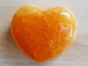 Highly polished Orange Calcite Heart approx 45 mm. www.naturalhealingshop.co.uk based in Nuneaton for crystals, spiritual healing, meditation, relaxation, spiritual development,workshops.