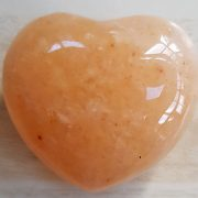Highly polished Aventurine Peach Heart approx 45 mm. www.naturalhealingshop.co.uk based in Nuneaton for crystals, spiritual healing, meditation, relaxation, spiritual development,workshops.