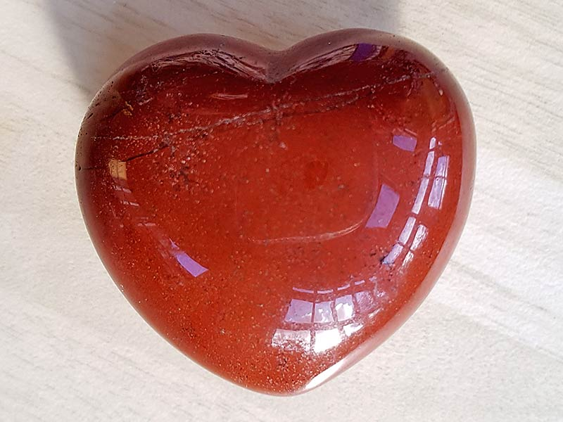 Highly polished Red Jasper Heart approx 45 mm. These hearts are perfect for a gift! There are purple velvet pouches or organza bags you can purchase to pop them into for the finishing touch. Being a natural product these stones may have natural blemishes and vary in colour and banding. www.naturalhealingshop.co.uk based in Nuneaton for crystals, spiritual healing, meditation, relaxation, spiritual development,workshops.