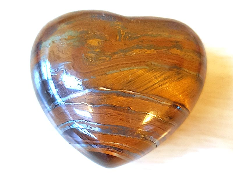 Highly polished Tiger Jasper Heart approx 45 mm. These hearts are perfect for a gift! There are purple velvet pouches or organza bags you can purchase to pop them into for the finishing touch. Being a natural product these stones may have natural blemishes and vary in colour and banding. www.naturalhealingshop.co.uk based in Nuneaton for crystals, spiritual healing, meditation, relaxation, spiritual development,workshops.