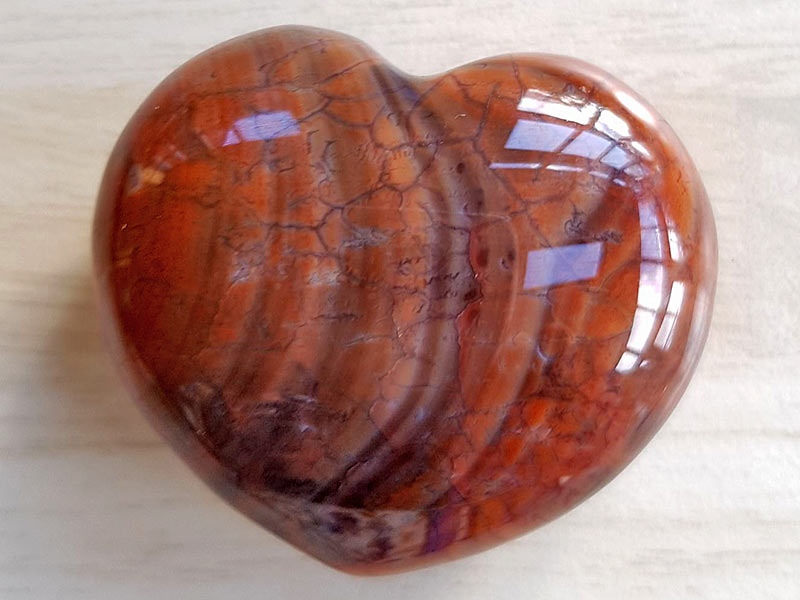 Highly polished Fire Agate Heart approx 45 mm. These hearts are perfect for a gift! There are purple velvet pouches or organza bags you can purchase to pop them into for the finishing touch. Being a natural product these stones may have natural blemishes and vary in colour and banding. www.naturalhealingshop.co.uk based in Nuneaton for crystals, spiritual healing, meditation, relaxation, spiritual development,workshops.