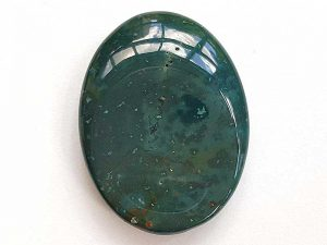 Highly polished Bloodstone thumb stone 40 x 30 mm. The thumb stones have been designed to have a pleasing feel with the highest quality finish. They are shaped to fit beautifully between the thumb and fingers. Being a natural product these stones may have natural blemishes and vary in colour and banding. www.naturalhealingshop.co.uk based in Nuneaton for crystals, spiritual healing, meditation, relaxation, spiritual development,workshops.